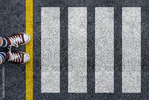 Valokuvatapetti man legs in sneakers standing next to pedestrian crossing