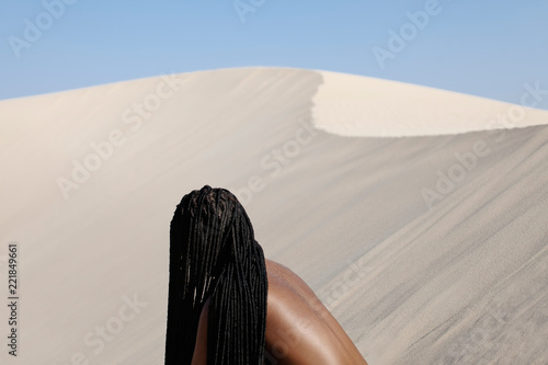 young woman and a sand dune