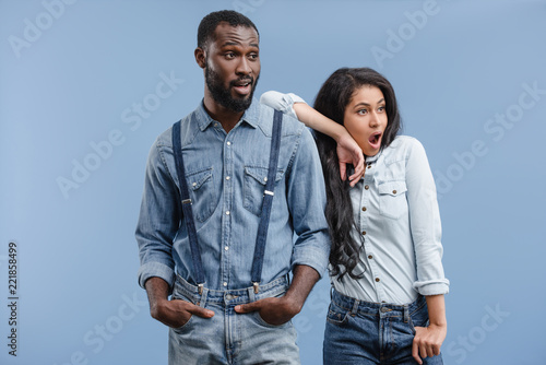 Valokuva  shocked african american couple looking away isolated on blue