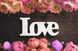 """canvas print picture - word """"love"""" on wooden background with many flowers"""