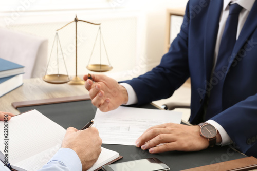 Lawyer working with client at table in office, focus on hands Canvas Print