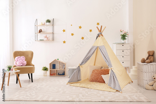 Cozy kids room interior with play tent and toys Canvas Print