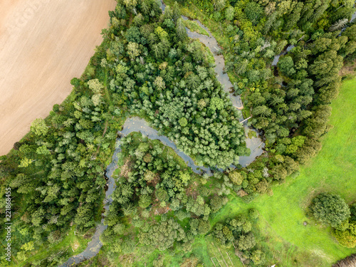 In de dag Lime groen drone image. aerial view of rural area with fields and forests with snake river in woods