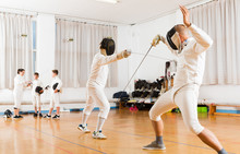 Fencing  Duel  Of Two L Athletes In Gym