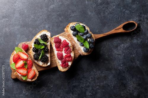 Brushetta or traditional spanish tapas with various berries