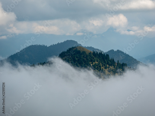 Fotobehang Bergen Mountains peaks in cloudy and foggy environments