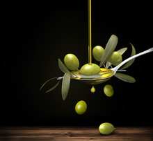 Olive Oil Jet Over A Olive Branch In A Spoon