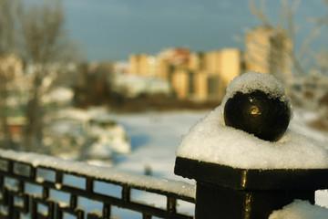 Obraz na płótnie Canvas fence covered snow winter park