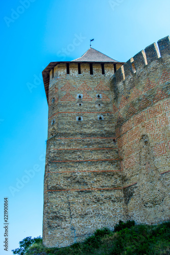 Spoed Foto op Canvas Kasteel Photo of ancient stone castle with many hight towers in Khotym