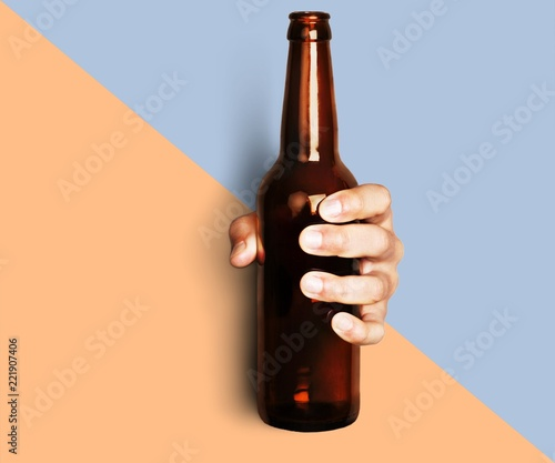 Obraz Hand holding beer bottle without label isolated on white - fototapety do salonu