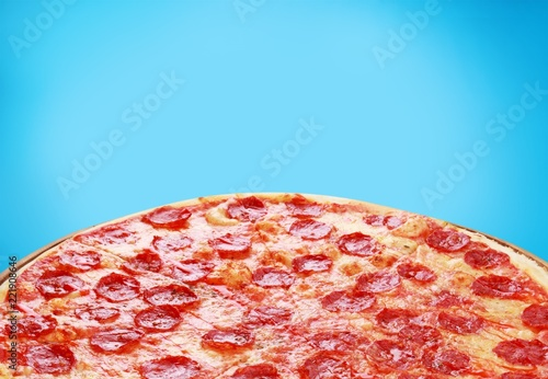 Fresh Tasty Pizza with Salami on wooden board