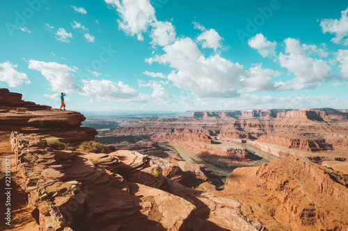 Canvas Prints Arizona Hiker on a cliff in Dead Horse Point State Park, Utah, USA