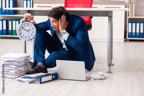 Fotografie, Obraz  Tired exhausted businessman working overtime in office