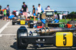 Kart racing park is the starting point for a team of racers at a blurred background.