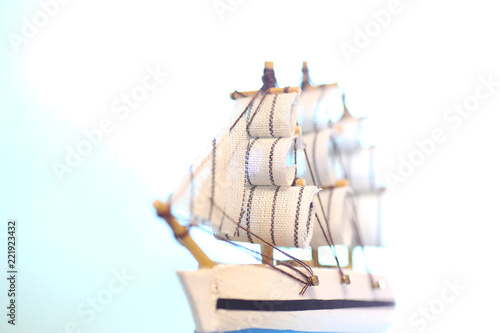 Old wooden ship with sails and masts toy on a stand. Vintage and