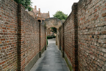 An Old Stone Brick Alley In Brugge, Belgium