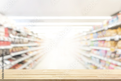 Wood table top in supermarket background, can be used for display or montage you Wallpaper Mural
