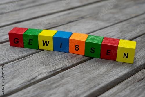 Fotografie, Obraz  Farbige Holzwürfel mit Buchstaben auf dem das Wort Gewissen abgebildet ist, Abst