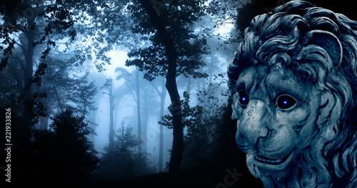 Foto op Canvas Groen blauw Ancient lion statue in misty forest