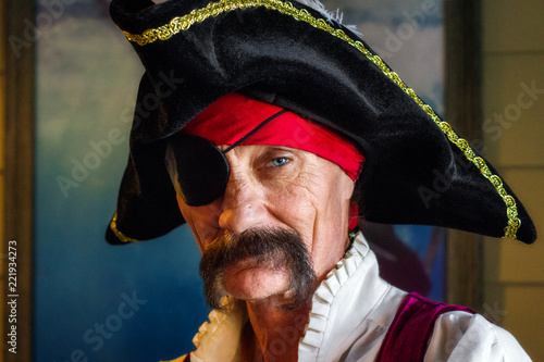 Pirate with an Eye Patch and One Piercing Eye Looks Intesly at the Camera He Has Wallpaper Mural