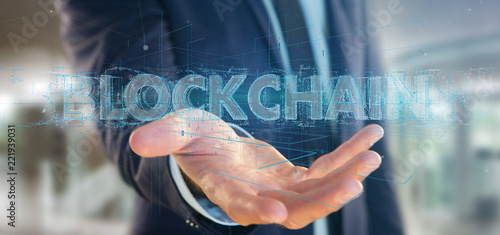 Businessman holding a Blockchain title isolated on a background