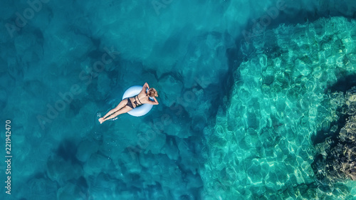 Wall Murals Green coral Aerial view at the girl on sea. Turquoise water from air as a background from air. Natural seascape at the summer time. Seascape from drone