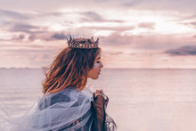 Fashion Model Portrait. Young Pretty Woman With Crown Outdoors At Sunset