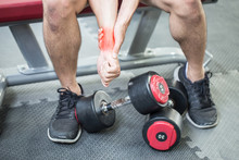 Man Injury Wrist Pain After Workout With Dumbbell In Gym,Healthcare Concept