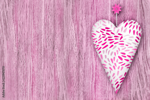 Heart against wooden background