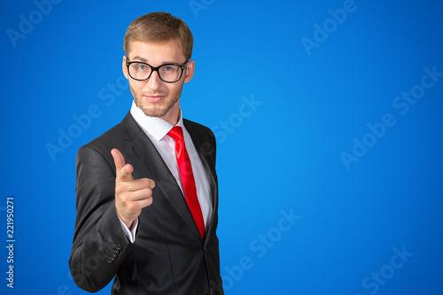 Obraz na plátně Young handsome businessman pointing on you