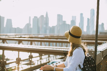 Young Woman Standing On Brooklyn Bridge In New York Nwith The View Of Manhattan