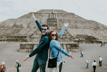 .Young Carefree And Lovely Couple Of Tourist Enjoying The Pyramids Of Teotihuacan In Mexico. Lifestyle Portrait.