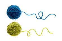 Blue And Green Woolen Balls Over White Background.