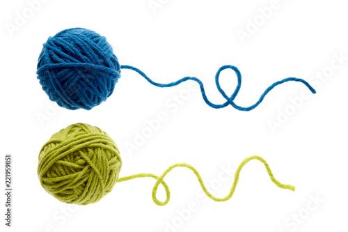 Fototapeta Blue and green woolen balls over white background.