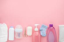 Set For A Newborn Nipple Bottle Diaper Socks Baby Body Slip Pink Background Top View Children's Hygiene
