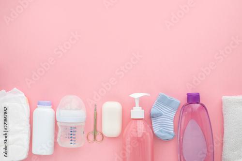 Fotografiet  Set for a newborn nipple bottle diaper socks baby body slip pink background top