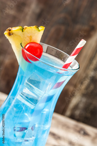 Spoed Foto op Canvas Cocktail Blue Hawaiian cocktail on wooden table.