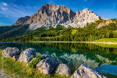 A beautiful view on the Ehrwalder Almsee and the Zugspitze on a sunny summer day Wallpaper Mural