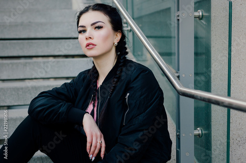 Fotografia, Obraz People, beauty, fashion, lifestyle concept -Young sexy woman with braids dressed in black pants and a black bomber jacket