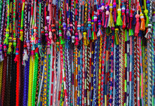 Colorful Vivid Multicolored String Beaded Clip In Hair Wraps Made Of Yarn. Artisan Had Crafted Goods. African Style. Beautiful Pattern. Travel Local Ethnic Culture Concept. Lifestyle