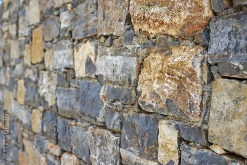 Foto op Plexiglas Wand Part of grunge colorful stone blocks wall.