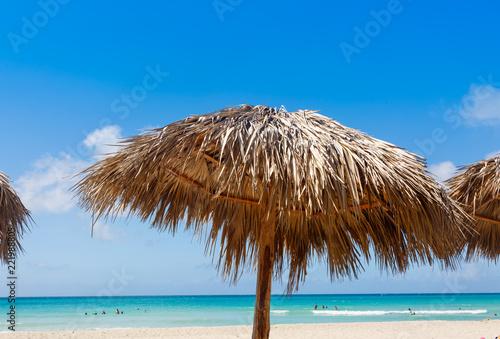 Fotografie, Obraz  Straw Hut on a Beach in Cuba