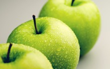 Row Of Green Apples On Green Background