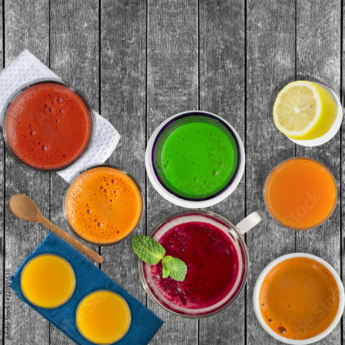 Garden Poster Juice Set of different vegetable juices and fruit drinks, mint leaf and lemon on rustic wooden table. Concept of healthy eating and drinks. Top view. Copy space,