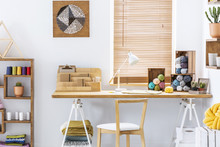 Wooden Chair At Desk With Lamp...