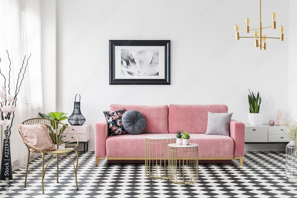 Fotografiet Poster Above Pink Sofa In Living Room