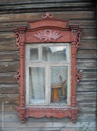 a window with decorative outside architrave in traditional style and a mill insi Canvas Print