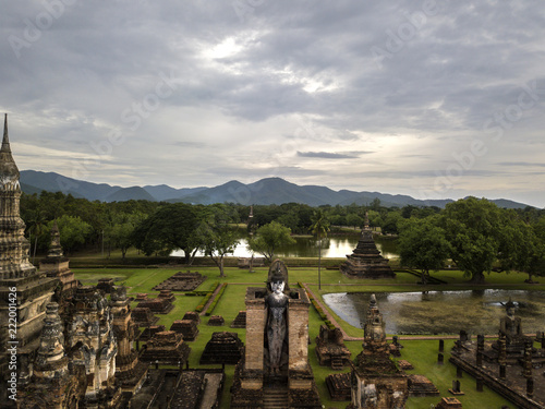 Poster Donkergrijs Aerial View of a historical sites ruins Buddhist Temple Wat Mahathat at The Sukhothai Historical Park, a registered UNESCO World Heritage City in the tranquil late afternoon sun