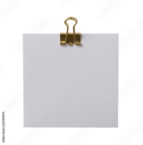 White note with a golden paperclip - Buy this stock photo