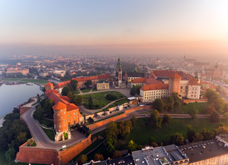 Fototapeta Kraków Aerial view Royal Wawel Castle and Gothic Cathedral in Cracow, Poland, with Renaissance Sigismund Chapel with golden dome, fortified walls, yard, park and tourists.